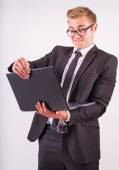 The young businessman looking at laptop — Stock Photo