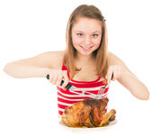 Young girl on a diet begins to eat the chicken — Stock Photo