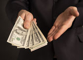 Businessman wants so you took the money — Stock Photo