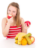 Beautiful girl taking a bite of the apple — Stock Photo