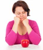 Full woman looking at apple — Stock Photo
