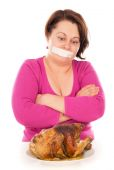 Full woman on a diet, want to eat chicken — Stock Photo
