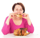 Full woman greedily absorbing piece of chicken — Stock Photo