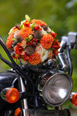Wedding bouquet on a motorcycle — Stock Photo