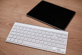 Aluminum keyboard with the tablet — Stock Photo