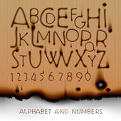Vintage alphabet and numbers on burned out paper background — Stock Vector
