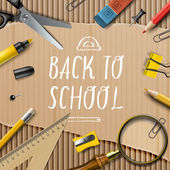 Welcome Back to school template with schools supplies on cardboard texture background — Stock Vector