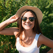 Beautiful young woman in stylish hat — Stock Photo