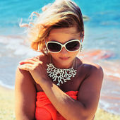 Fashion blonde female in vacation — Stock Photo