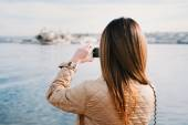 Fashion  woman taking photo with cellphone — Stock Photo