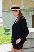 Stylish Parisian woman poses on a photoshoot — Stock Photo