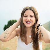 Beautiful modern woman with long hair — Stock Photo