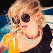 Young sexy fashion woman drinking cocktail — Stock Photo