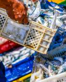 Fishermen arranging containers with fish — Stock Photo