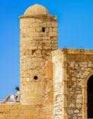 Ancient part of a tower with arched doorways — Stock Photo
