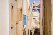 Narrow lane with windows facing each other — Stock Photo