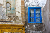 Old building with a blue window — Stock Photo