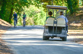 Two men riding in an electric sportive tourist car — Stock Photo