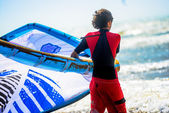 Closeup to a young man preparing to kitesurf — Foto de Stock