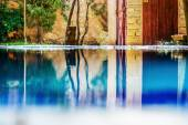 Reflection of the backyear on the pool waters — Stock Photo