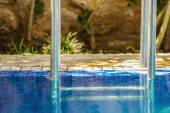 Closeup to the shiny railing of the swimming pool  — Stockfoto