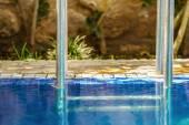 Closeup to the shiny railing of the swimming pool  — Foto de Stock