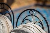 Metallic chairbacks with white cushions on them — Foto de Stock