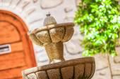A designed stone fountain in the backyard — Stock Photo