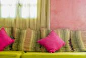 Bright colorful cushions on the sofa — Stock Photo