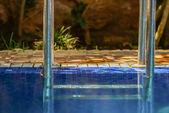 Closeup to blue water and pool metalic railings — Stock Photo