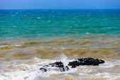 Waves of the sea washing the rock and color of the sea changing  — Stock Photo