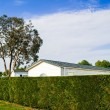 Mobile home with a beautiful natural fence — Stock Photo #52815869