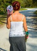 Woman walking down road — Stock Photo