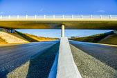 Highway under a new bridge — Stock Photo