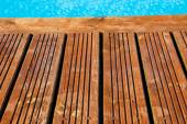 Swimming pool with treated wood damaged — Stock Photo