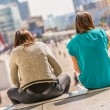 Two young ladies having outdoor lunch — Stock Photo #54585097