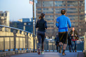 Two people with healthy lifestyle running along the bridge in th — Stock Photo