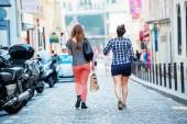 Two young ladies walking right in the middle of the street — Stock Photo