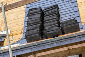 A roof in construction with slates — Stock Photo