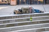 Homeless sleeping on the top of stairs — Stock Photo