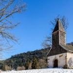 Beautiful small church set among the snow — Stock Photo #66073197