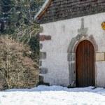 Beautiful small church set among the snow — Stock Photo #66073359