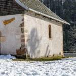 Beautiful small church set among the snow — Stock Photo #66073517