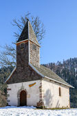 Beautiful small church set among the snow — Stock Photo