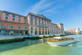 VENICE, ITALY - MAR 18 - Taxi boat on Canal Grande with Venezia — Stock Photo