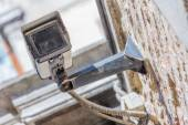 Closeup view of security camera and urban video — Stock Photo