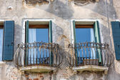 Closeup on windows windows of a typical Venetian house, Italy — Stock Photo