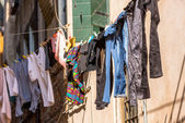 Venetian windows with the laundry drying on a wire — Stock Photo