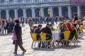 VENICE, ITALY - MAR 19 - Tourists at San Marco square have a rest in one of many cafes with live music on Mars 19, 2015 in Venice, Italy.  — Stock Photo