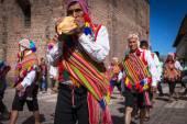 Unknown Peruvian people in traditional clothes on a carnival in Cuzco, Peru